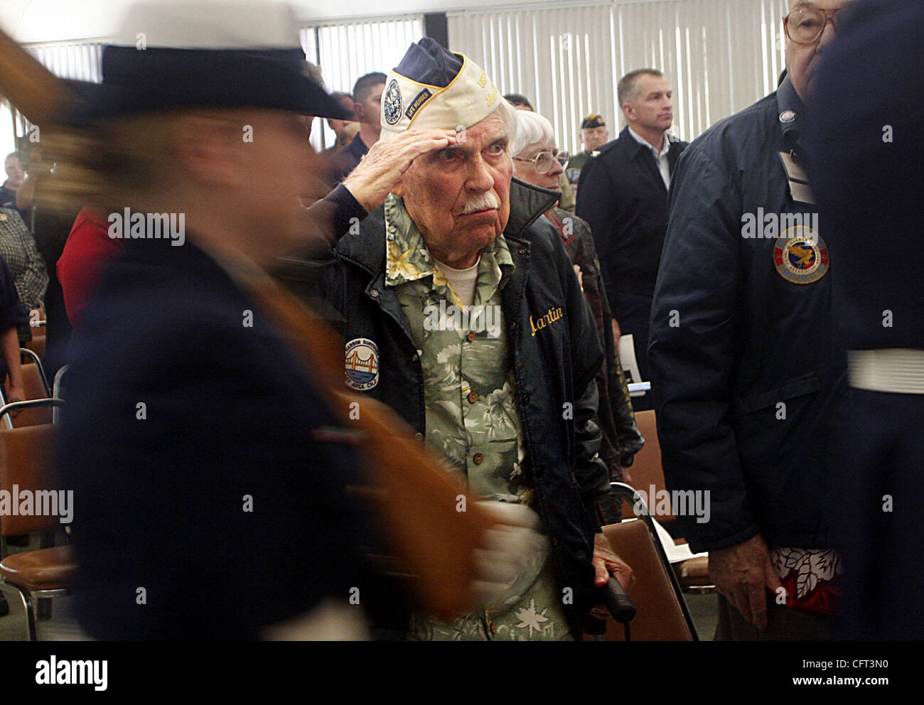 Pearl Harbor Survivors Association member Martin Schwager, who served in the Army at Ft. Shafter, HI., salutes as Stock Photo