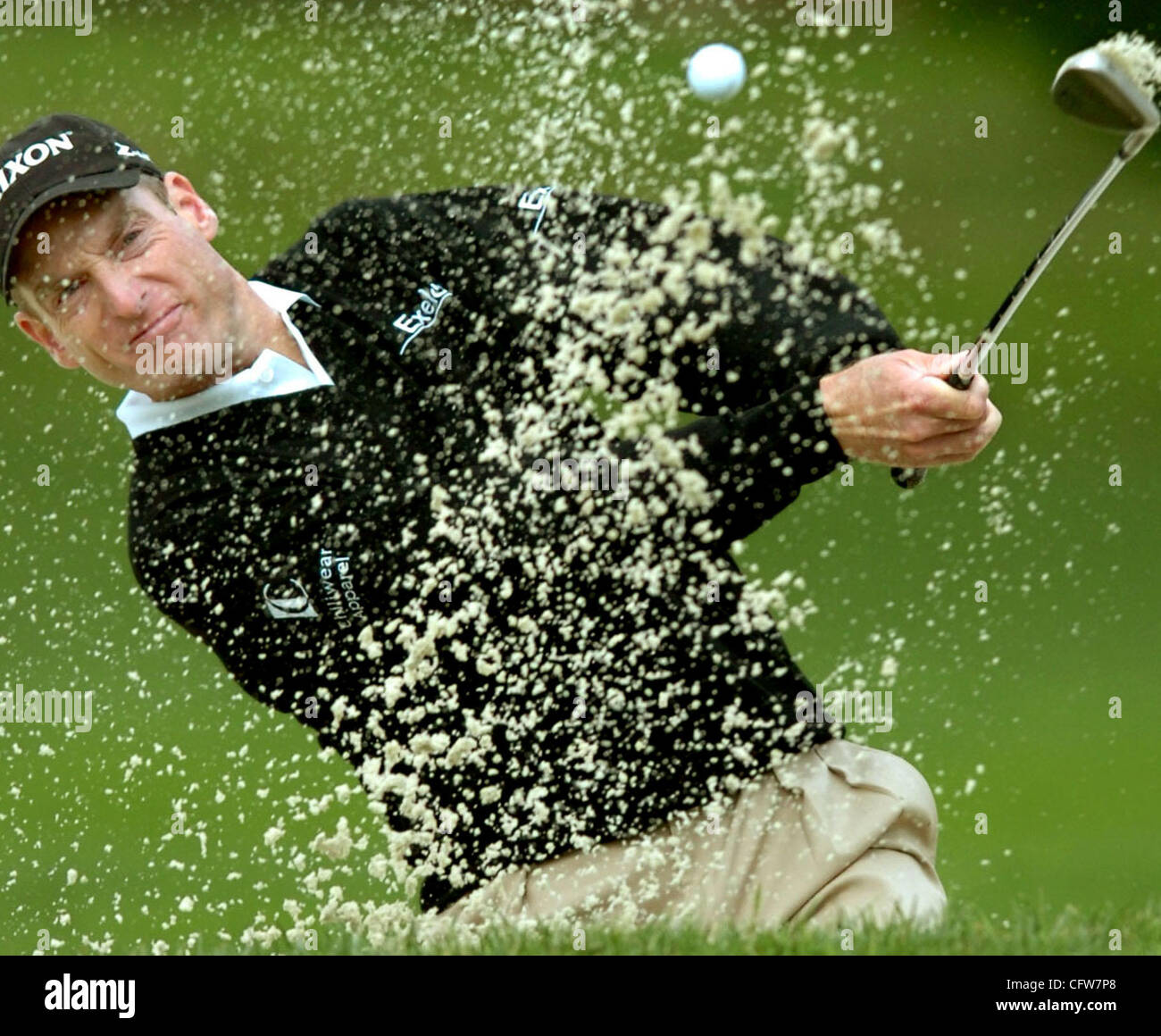 In Pebble Beach, Calif., on Saturday, February 10, 2007, Jim Furyk hits the ball out of the bunker on the 2nd green - Stock Image