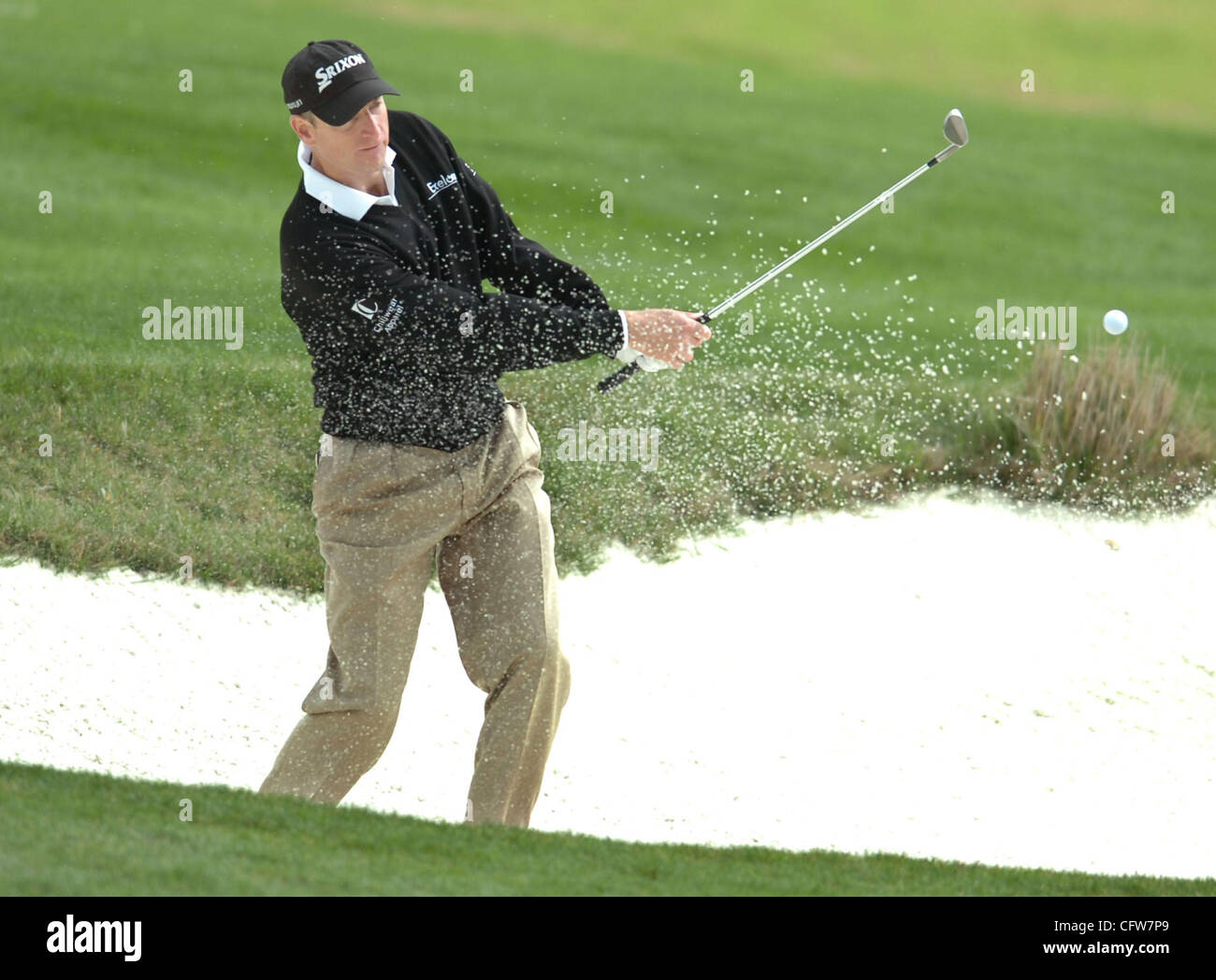 In Pebble Beach, Calif., on Saturday, February 10, 2007, Jim Furyk  hits the ball out of the bunker on the 8th green - Stock Image