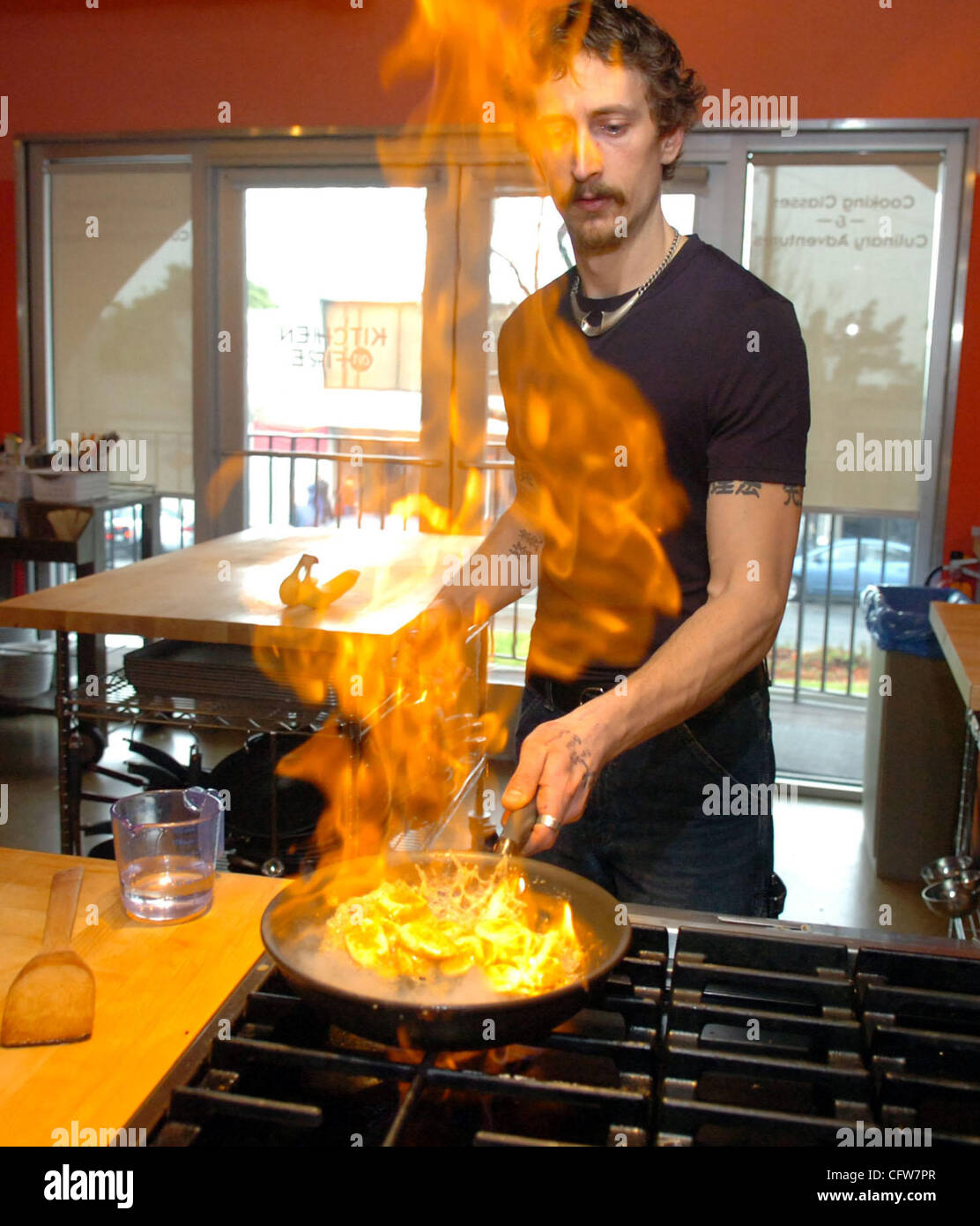 MikeC flambe\'s bananas using vodka at his cooking school, Kitchen on ...