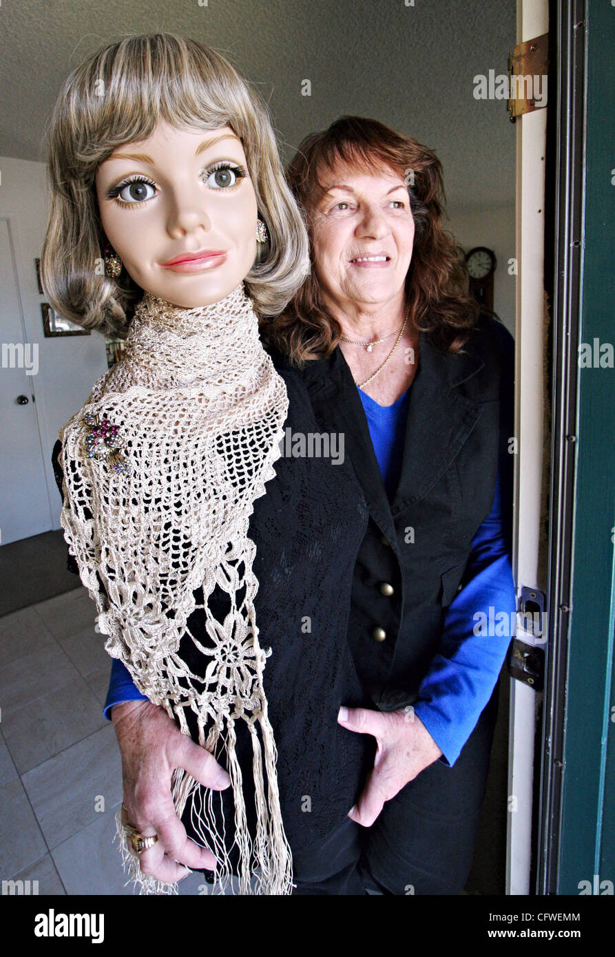 Kadie Amaral and one of her mannequins greet guests at her Livermore front door. (Jay Solmonson/Tri-Valley Herald) - Stock Image
