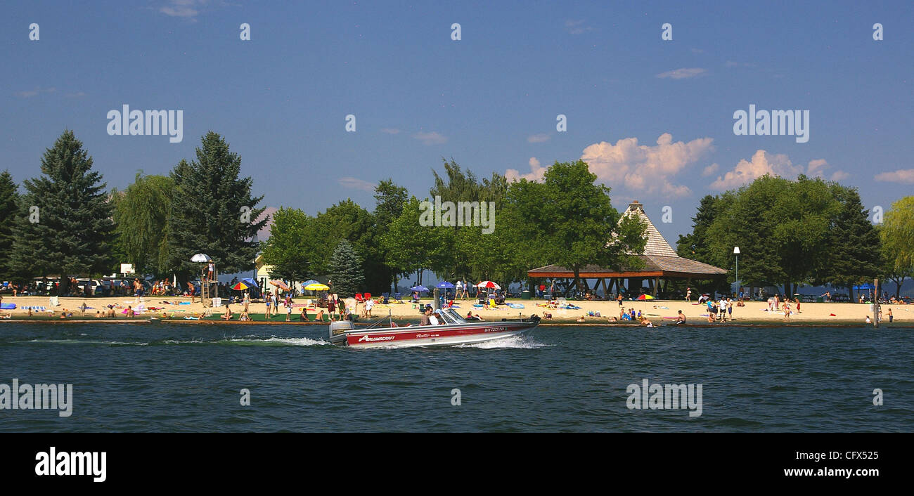 The beach at Sand Point offers a lovely vista of Lake Pend Oreille and plenty of room to spread out, swim and boat. - Stock Image