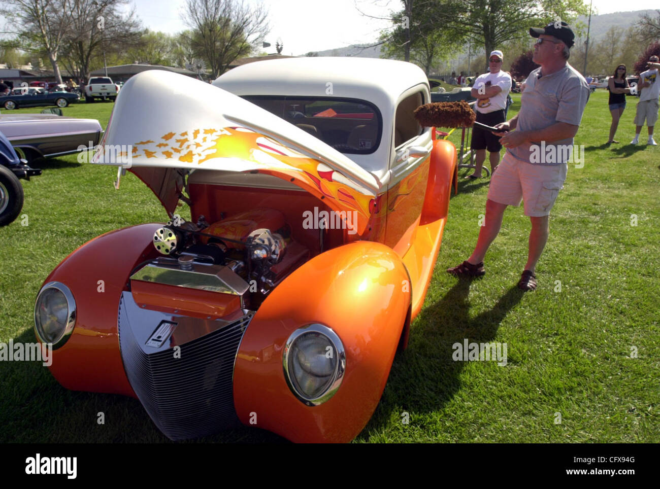 Mike Jones Of Selma Cleans His Custom 1941 Ford Truck That Is Made Mercury Cars From Two Trucks And Has A 350 Ram Jet Engine During The Goodguys Car Show Swap On