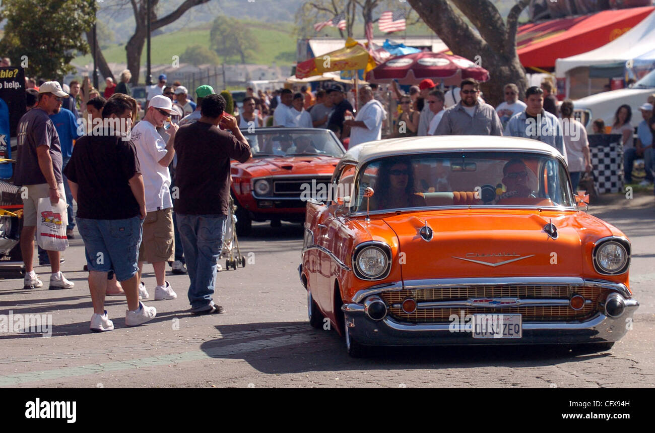 A parade of classic and custom cars makes their way through the ...
