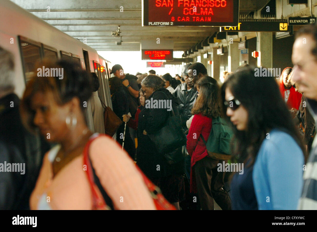 BART riders crowd onto a San Francisco-bound train at the El Cerrito Del Norte station in El Cerrito, Calif., on - Stock Image