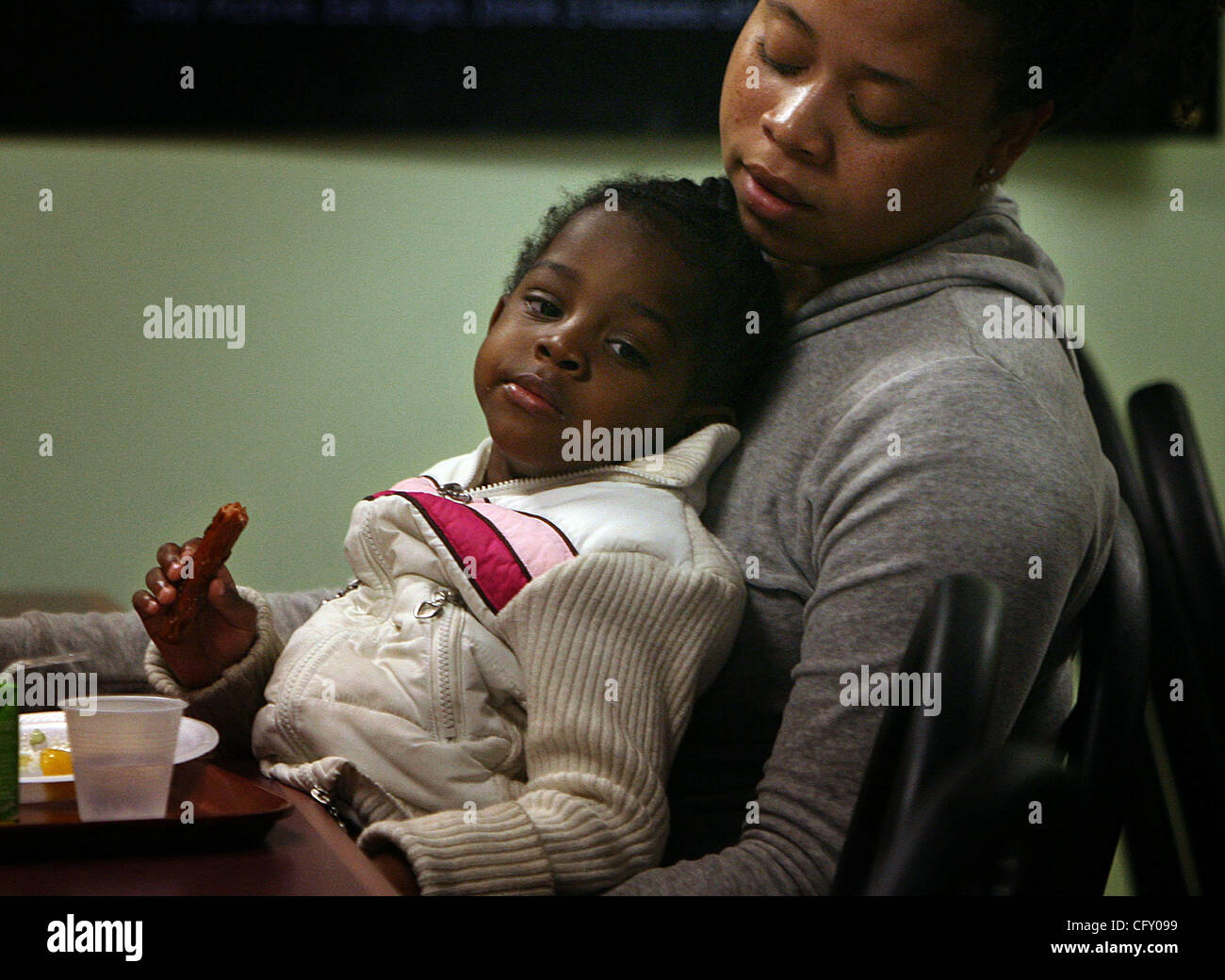 Minneapolis/April 20 2007/5:00PM.Keisha Harding relaxes with her daughter, Valerie, 3, during the Kids Carnival - Stock Image