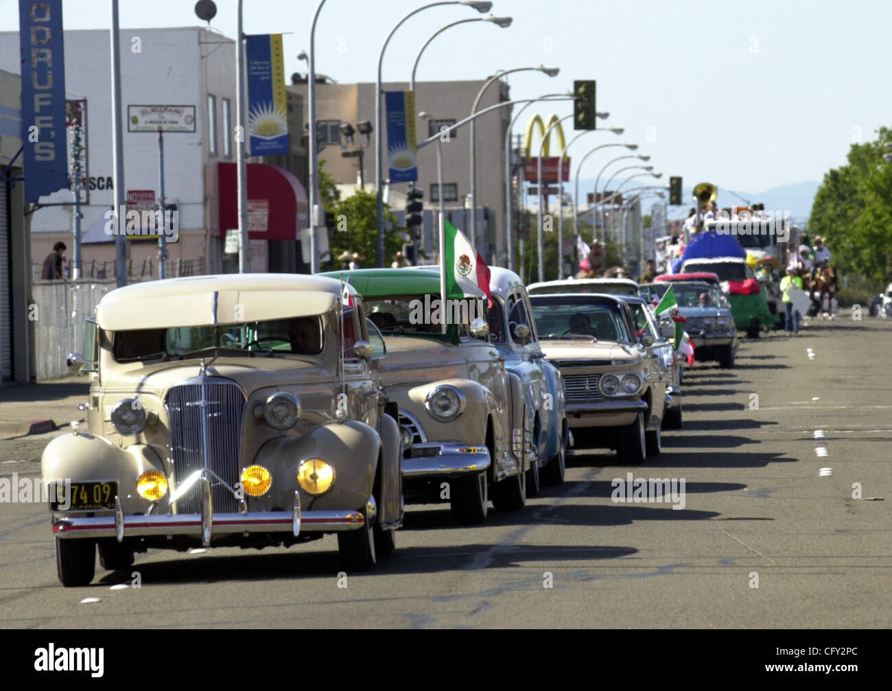 A line of classic cars and lowriders from Raza Unida Car Club make ...