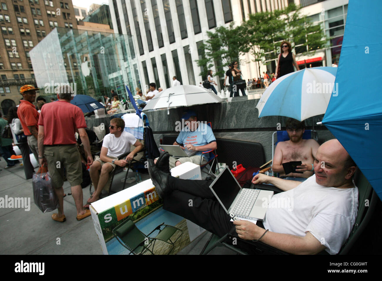 people wait in line in front of the apple store to be the first to purchase an iphone in new york, thursday, june - Stock Image