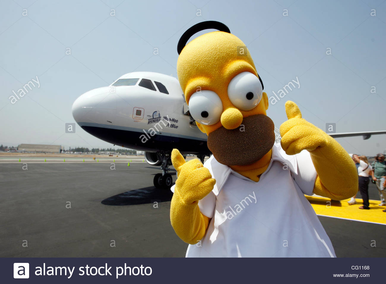 Character From The Simpsons Movie Homer Stands On The Tarmac Stock Photo Alamy
