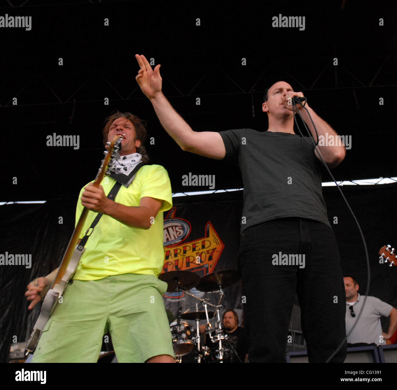 Jul. 23, 2007; Charlotte, NC USA;  Bass Guitarist JAY BENTLEY and Singer GREG GRAFFIN of the band BAD RELIGION performs - Stock Image