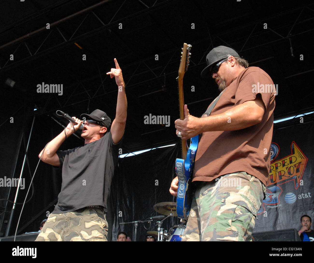 Jul. 23, 2007; Charlotte, NC USA; Singer JIM LINDBERG and Guitarist FLETCHER DRAGGE of the band PENNYWISE performs - Stock Image