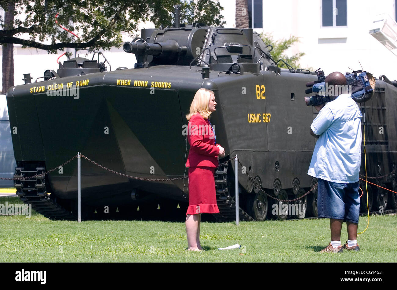 CHARLESTON, SC - JULY 23: A television reporter does a stand-up near a Marine amphibious assault vehicle near the Stock Photo