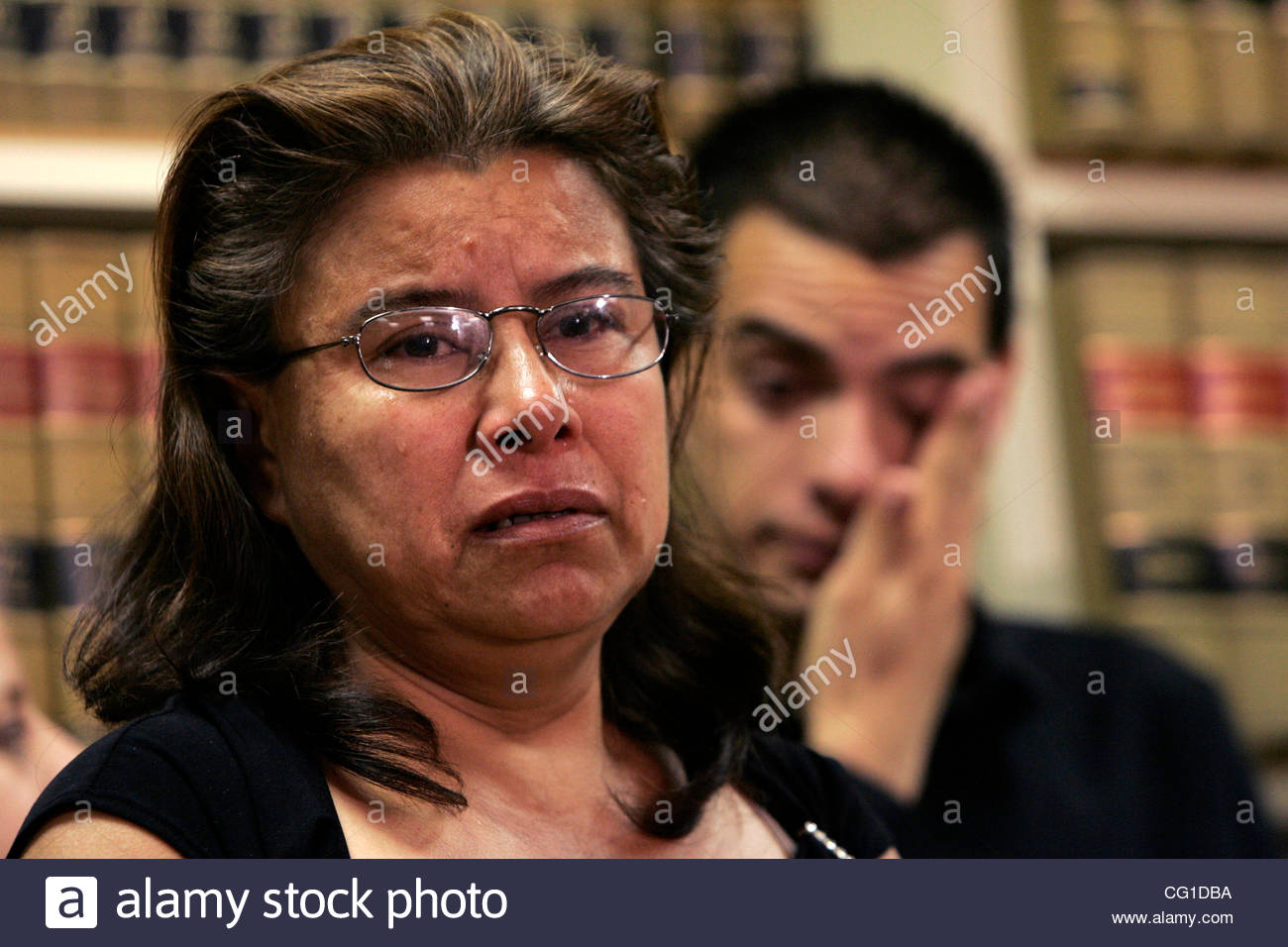 Maria Cabraja, mother of Pedro Guzman,  speaks to reporters  at a press conference relating to the reuniting of - Stock Image