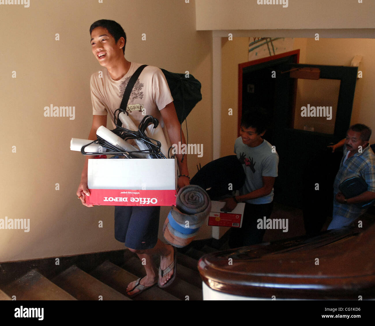 Ryc Oca, 18, right, and his family move his stuff into his