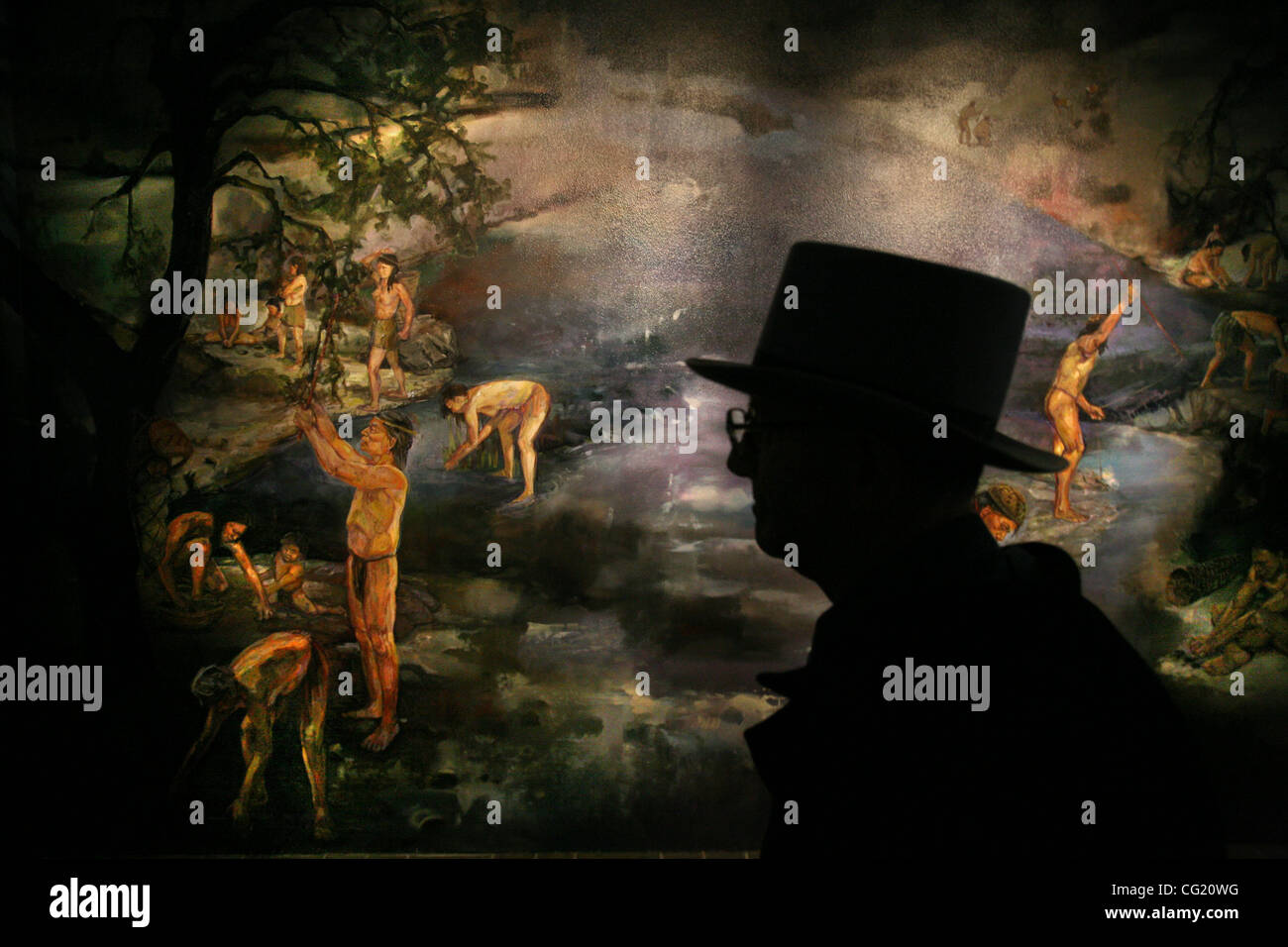 Inside the Marshall Gold Discovery HIstorial Park Museum, visitor Rene Simonis of Garden Valley looks at a mural, - Stock Image