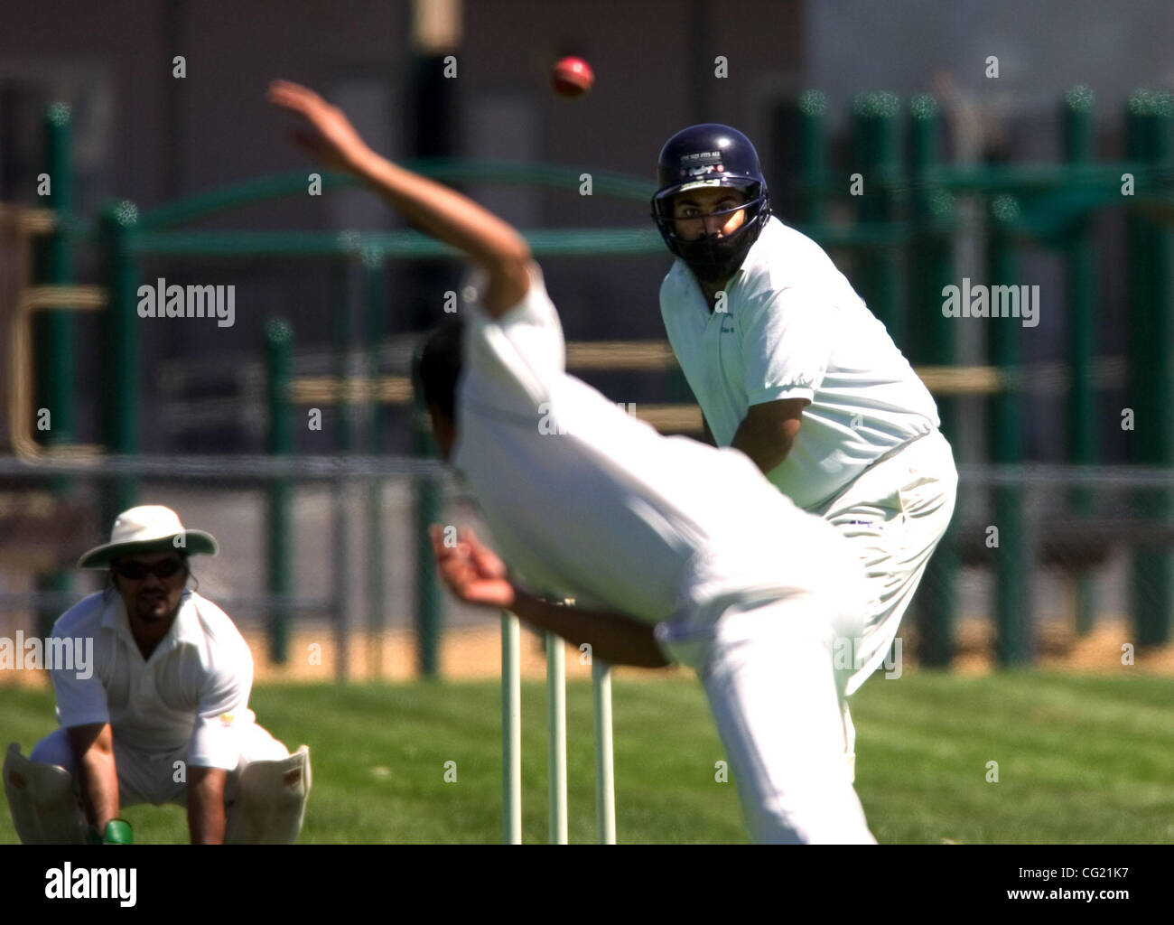 Monty Bhatia (cq - in helmet), of the Roseville Cricket Club, faces a Tiger Cricket Club (Sacramento) bowler Saturday, - Stock Image