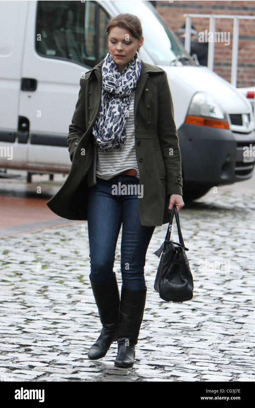bdcd9b468e Kate Ford trips on some cobbles as she crosses the road after leaving  Granada Studios Manchester