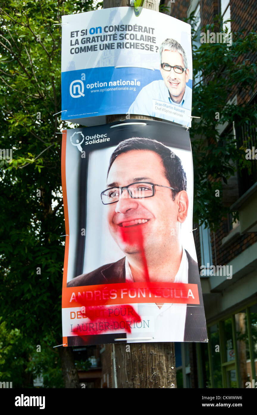 23rd Aug 2012. This candidate from Quebec Solidaire saw his image transformed overnight with red paint. Credit: Stock Photo