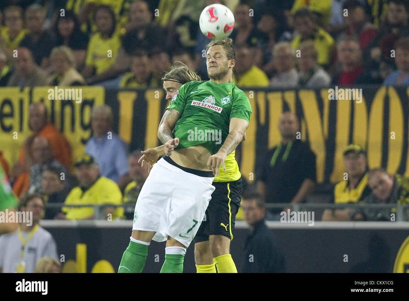 24.08.2012. Dortmund, Germany.  Borussia Dortmund versus SV  Werder Bremen. Marko Arnautovic  HB against Marcel - Stock Image