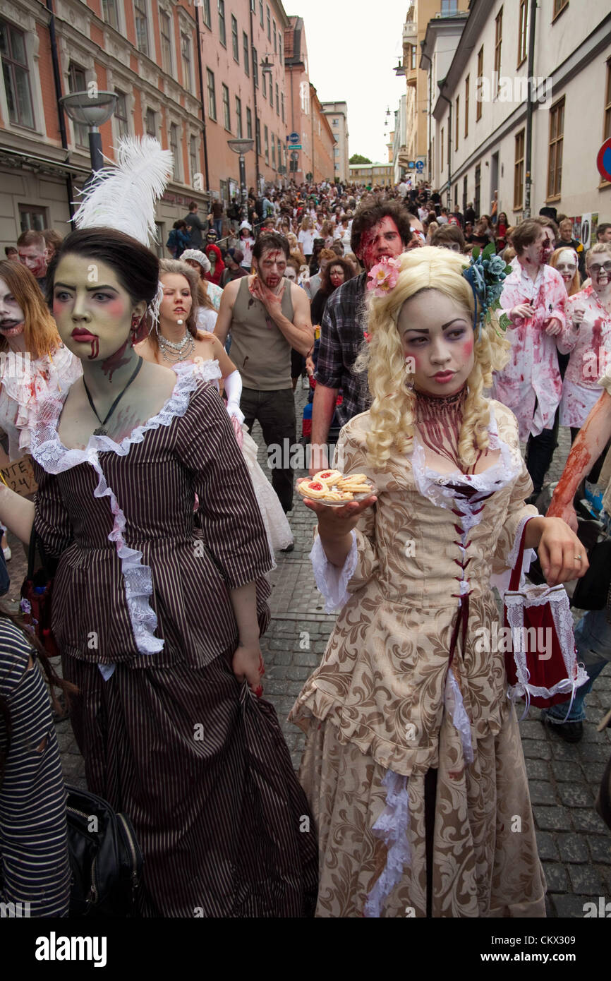 Zombies at Stockholm Zombie Walk 2012. Here two zombie women dressed in old clothing. - Stock Image