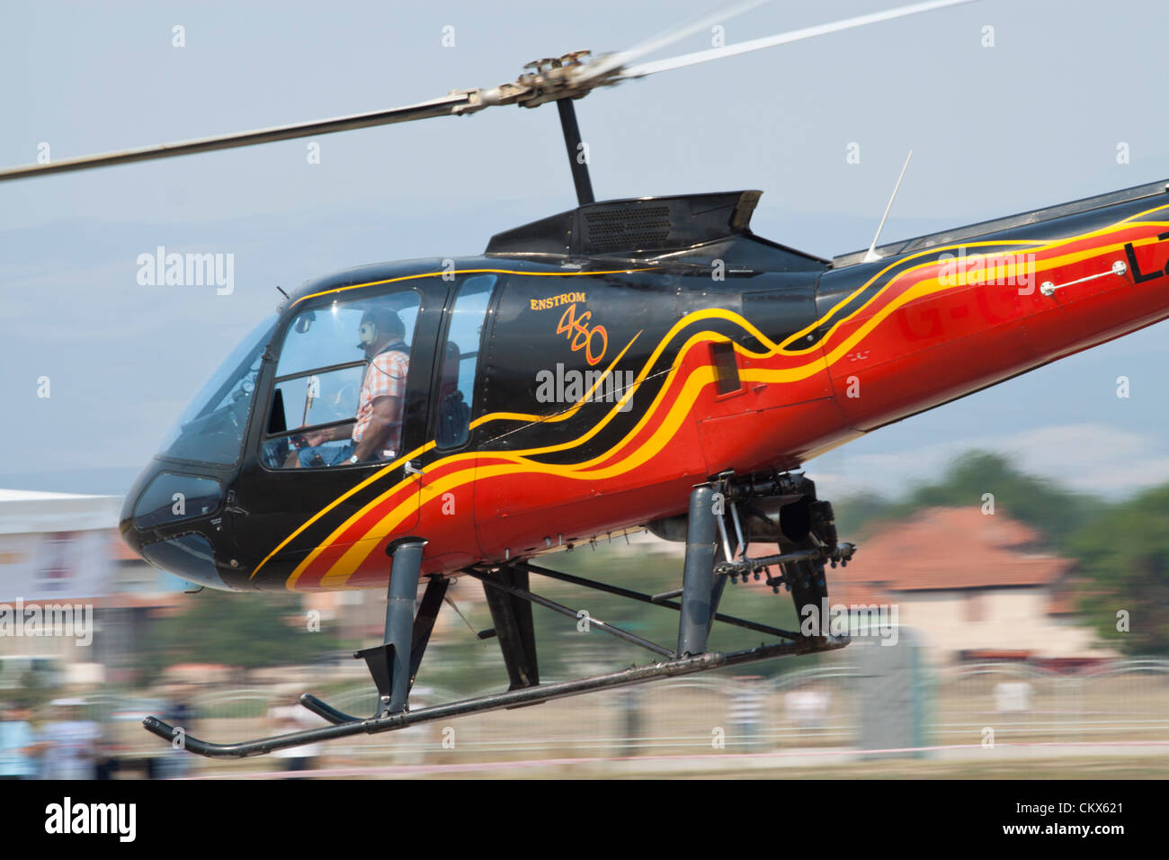 Lesnovo, Bulgaria; 24th Aug 2012. Enstrom 480 light helicopter during a very low fly-by. This aircraft is equipped - Stock Image