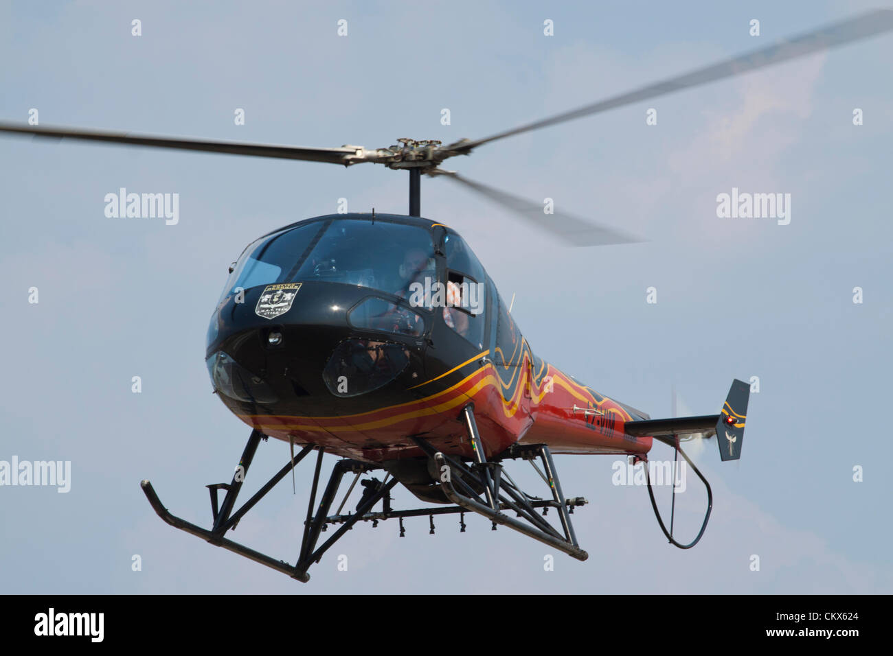 Lesnovo, Bulgaria; 24th Aug 2012. Enstrom 480 light helicopter hovering over the air field. This aircraft is equipped - Stock Image