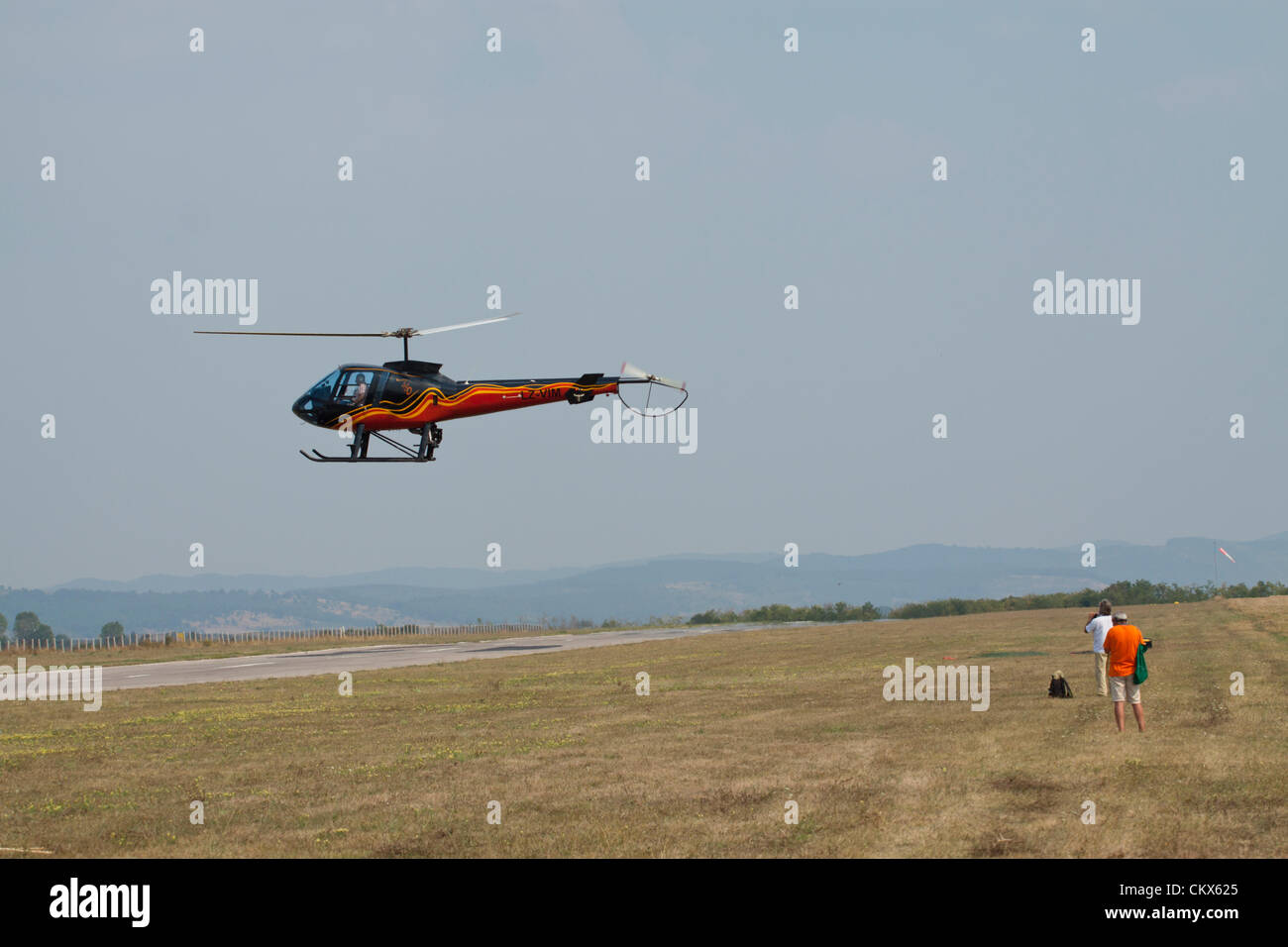 Lesnovo, Bulgaria; 24th Aug 2012. The Enstrom 480 flying sideways over the runway at Lesnovo, giving a perfect show - Stock Image