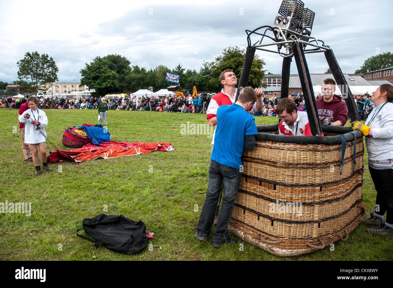26th Aug 2012. The John Harris (G-CDWD)  University of Bristol balloon is prepared for launch at the Tiverton balloon festival in Tiverton, Devon, UK. Stock Photo
