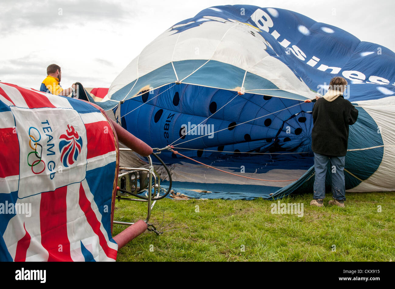 26th Aug 2012. G-SBIZ Cameron Z.90 Snow Business Hot Air Free Balloon is prepared for launch at the Tiverton balloon festival in Tiverton, Devon, UK. Stock Photo