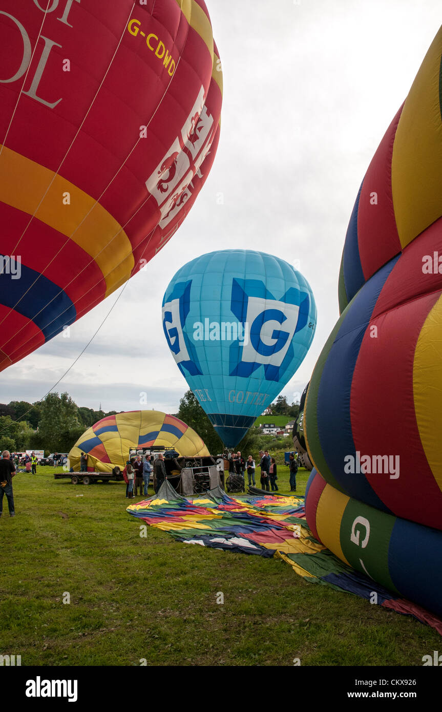 26th Aug 2012. The Cameron-Z Series (UK) (Gottex) (Z-90) (G-CCNN) balloon and the  John Harris (G-CDWD)  University of Bristol balloon is prepared for launch at the Tiverton balloon festival in Tiverton, Devon, UK. Stock Photo