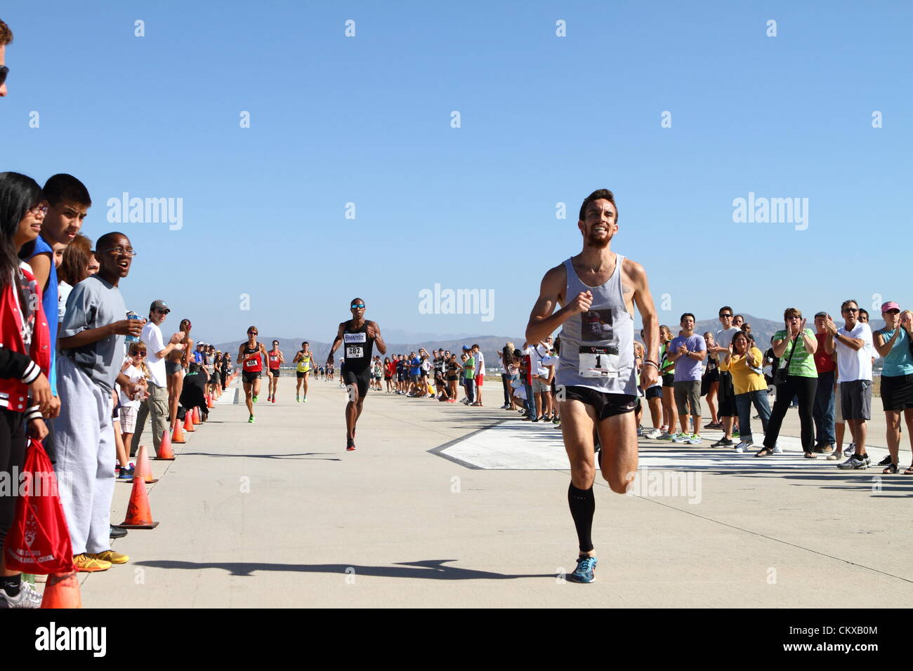 26th Aug 2012. Runner Andrew Acosta 24 from Los Angeles California wins the mens elite USATF Southern California - Stock Image