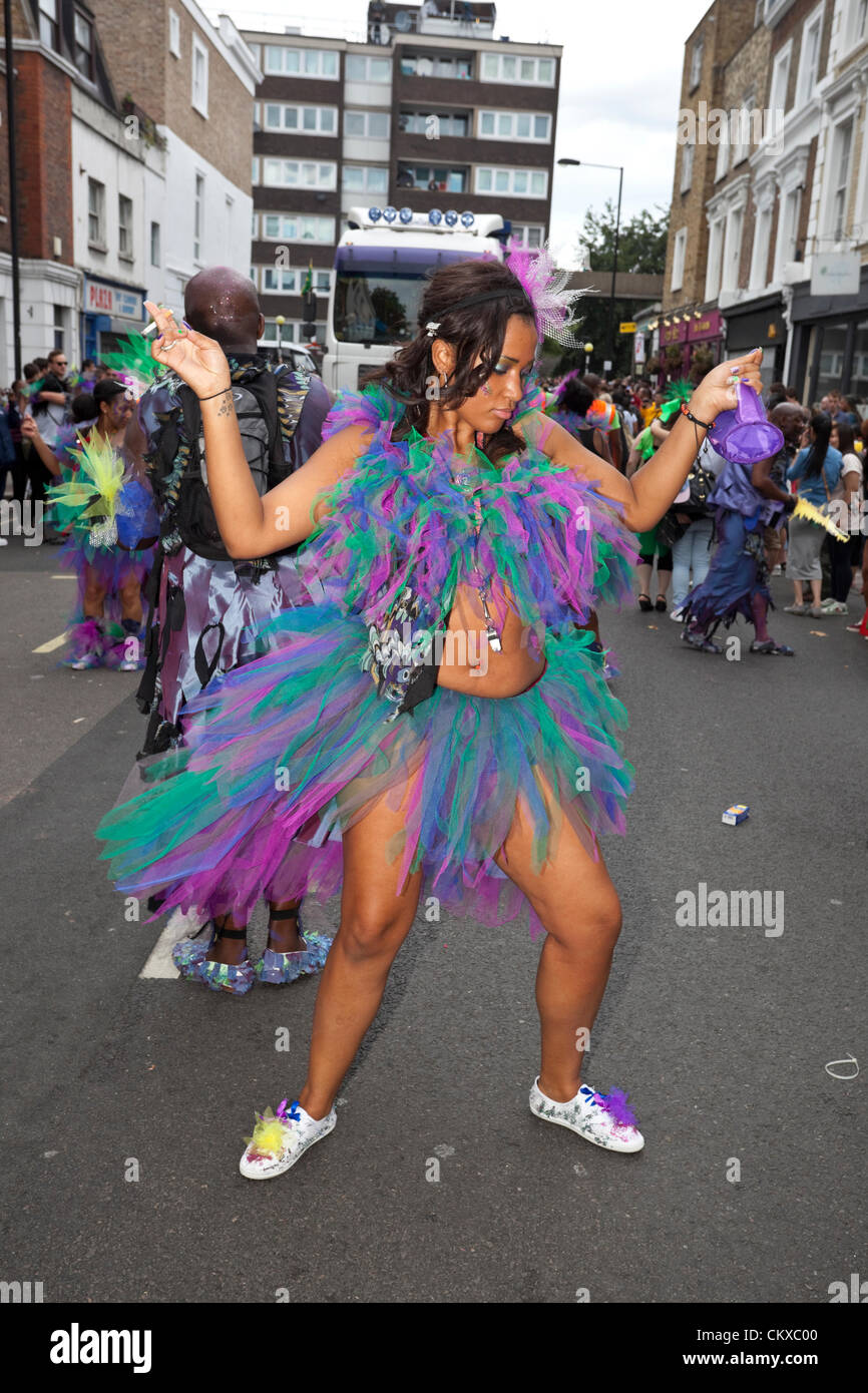 August 27th, 2012. London, UK. Notting Hill Carnival dancers perform in colourful costumes. - Stock Image