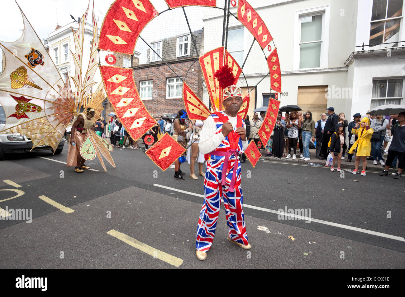 August 27th, 2012, London, UK. Notting Hill Carnival senior dancer wears colourful costume. - Stock Image