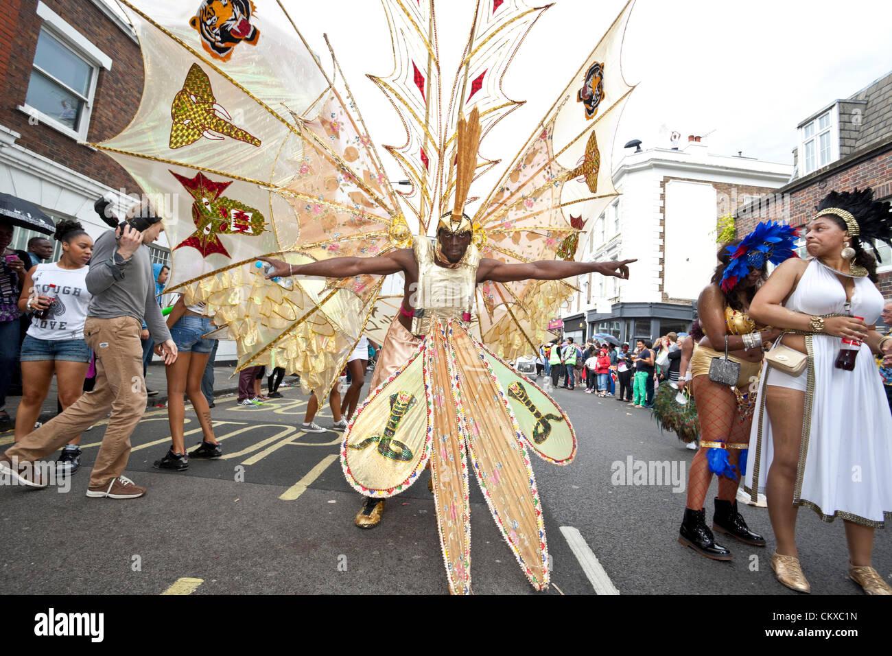 August 27th, 2012, London, UK. Notting Hill Carnival male dancer wears fantasy costume. - Stock Image