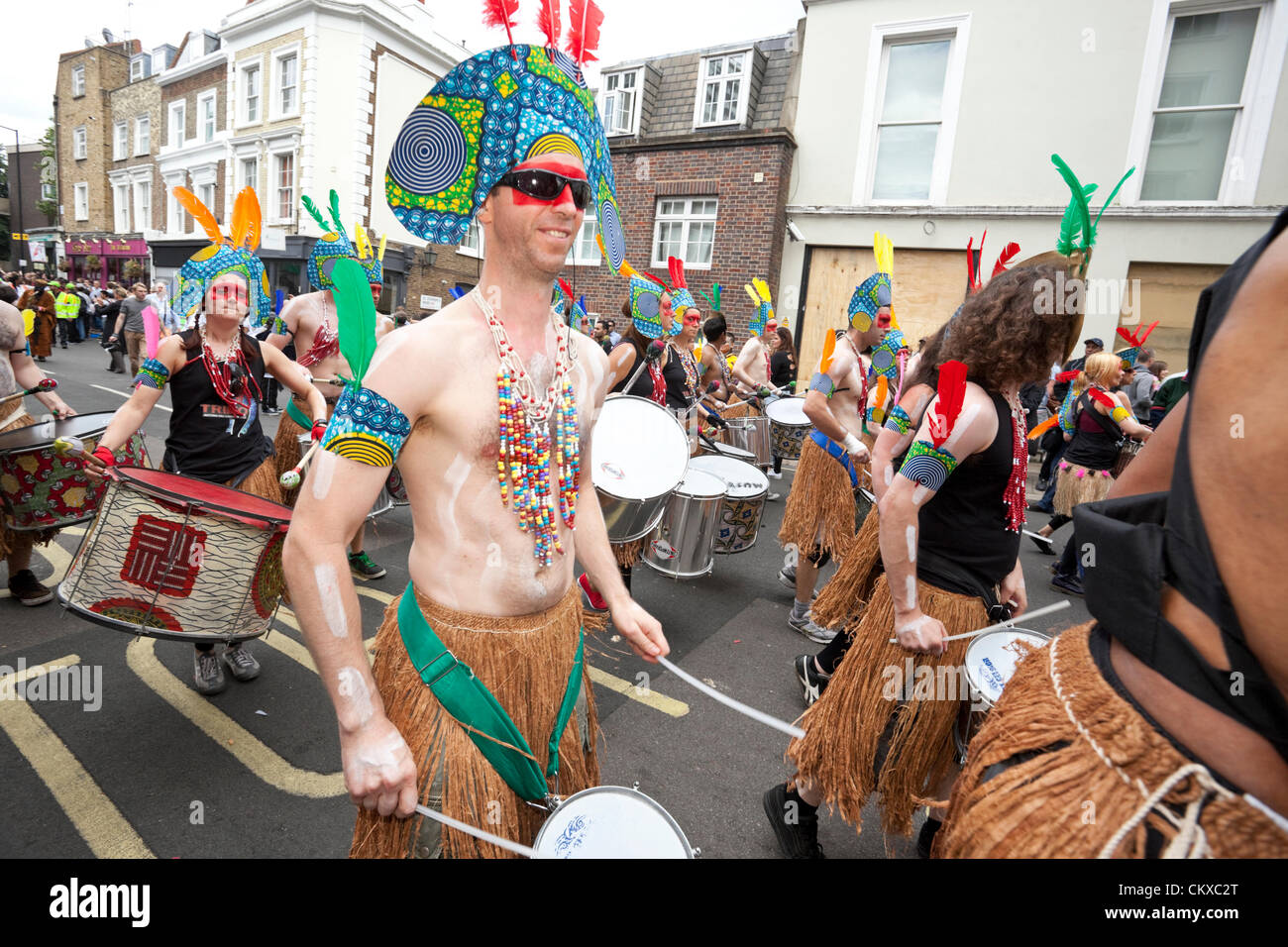August 27th, 2012, London, UK. Notting Hill Carnival drummers perform in colourful costumes. - Stock Image