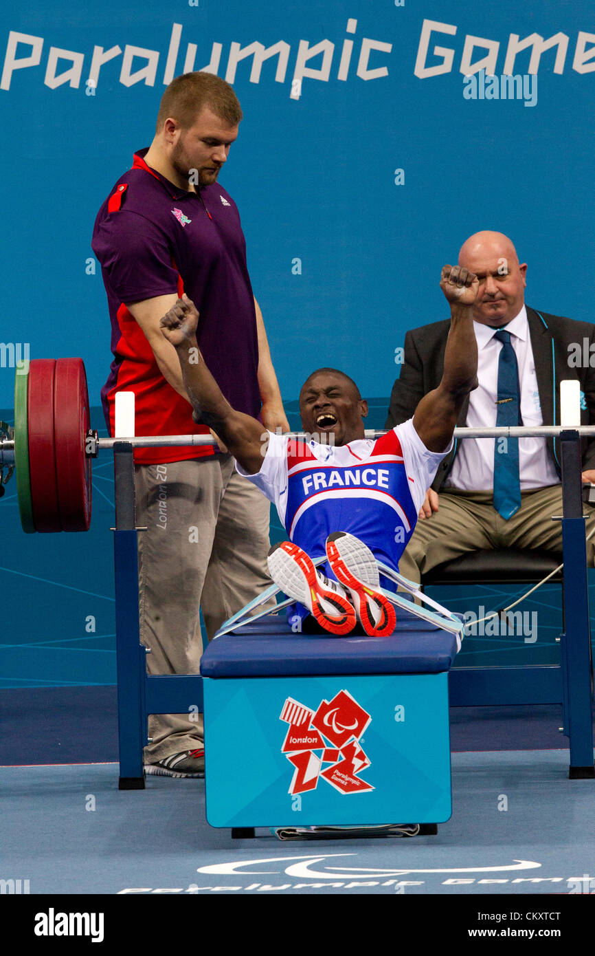 France's Patrick Ardon celebrates a successful lift in the men's 48kg powerlifting at the 2012 London Paralympics - Stock Image