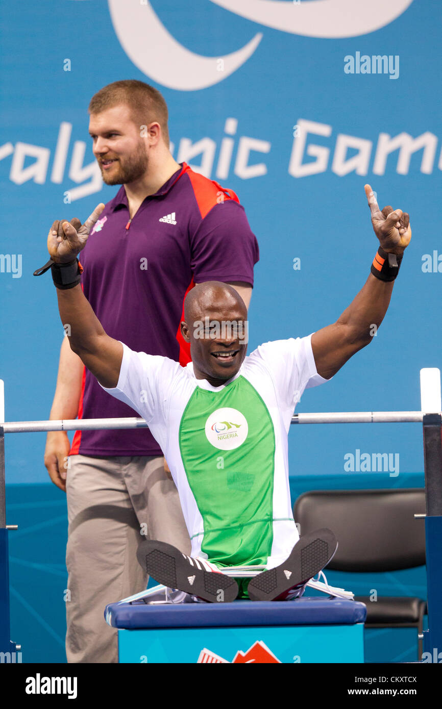 Nigeria's Ykubu Adesokan celebrates after setting world record in the men's 48kg powerlifting at the 2012 - Stock Image