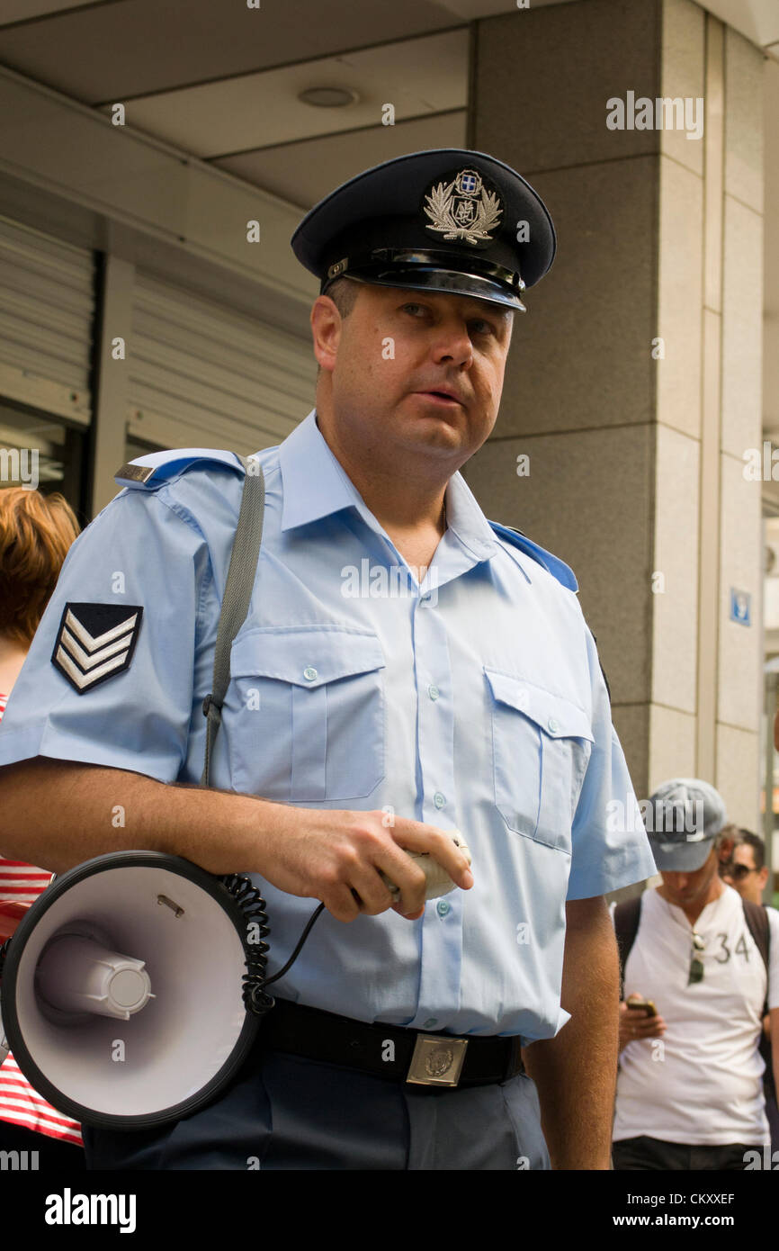 A protesting policeman with a megaphone. - Stock Image