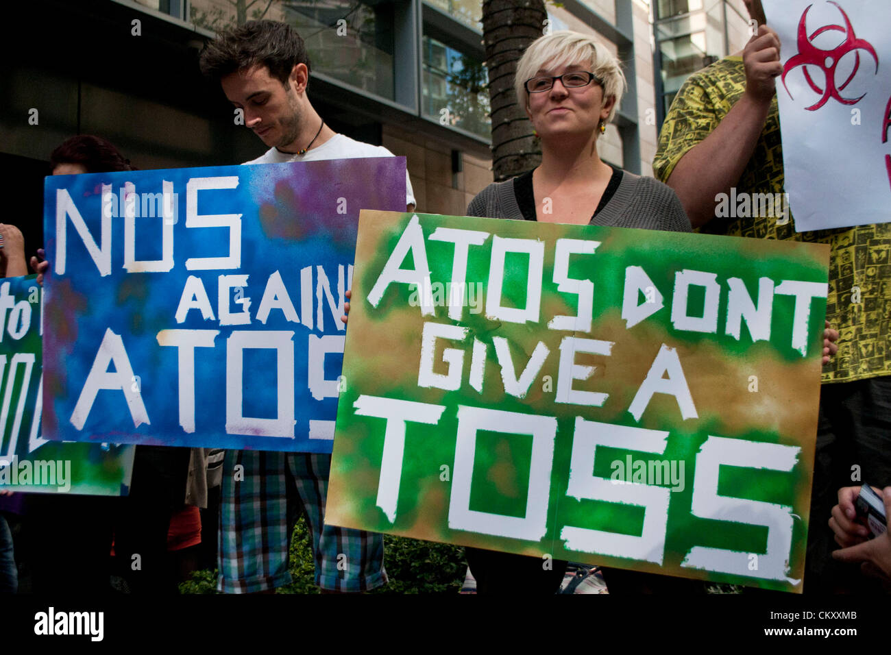London, UK. 31st Aug 2012. Protesters outside the offices of Atos protesting at Atos sponsorship of the Paralympic - Stock Image