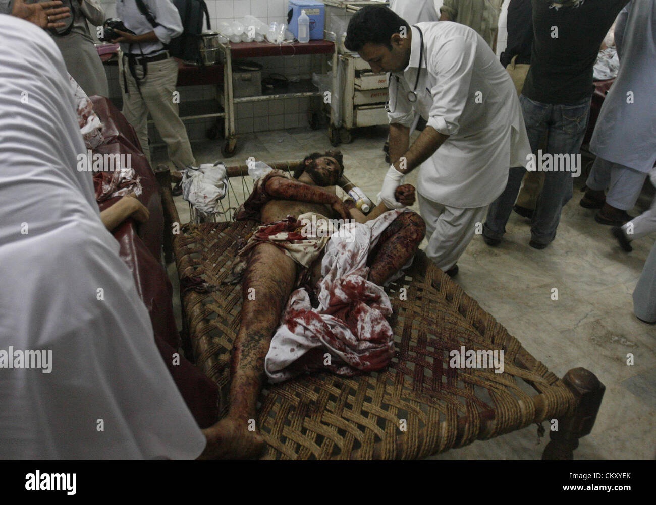 Paramedics busy in treatment of a bomb blast injures in Lady Reading hospital. A blast occurred in Matni Market - Stock Image