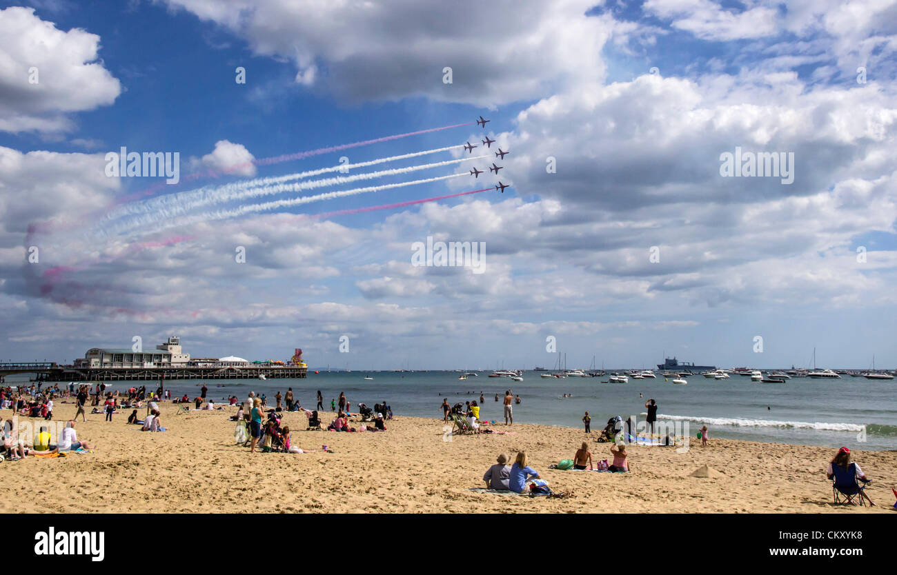The Red Arrows Aerobatics Team perform at Bournemouth, flying over the pier, beaches and Poole Bay, Dorset, England, - Stock Image