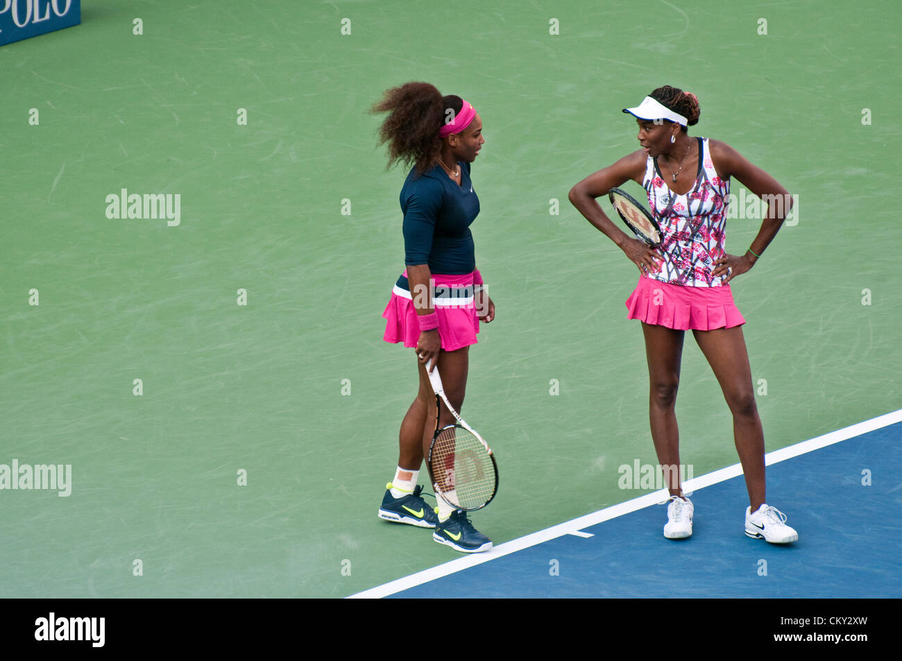 Serena Williams and Venus Williams of the USA during the women's doubles second round match against Kristina - Stock Image