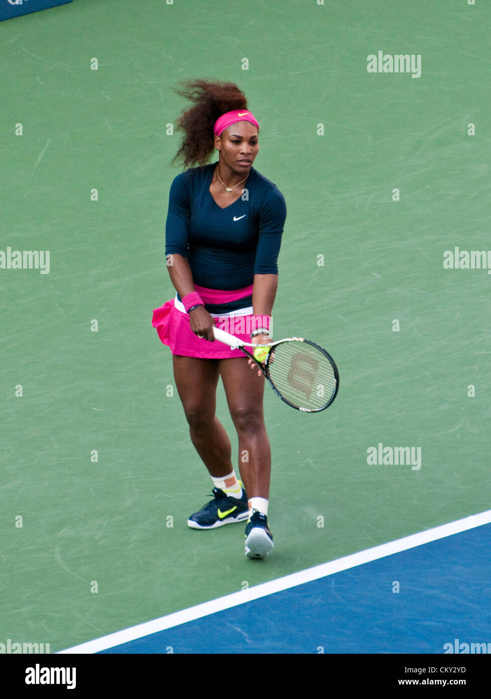 Serena Williams of the USA serving during the women's doubles second round match on Day Five of the 2012 US - Stock Image