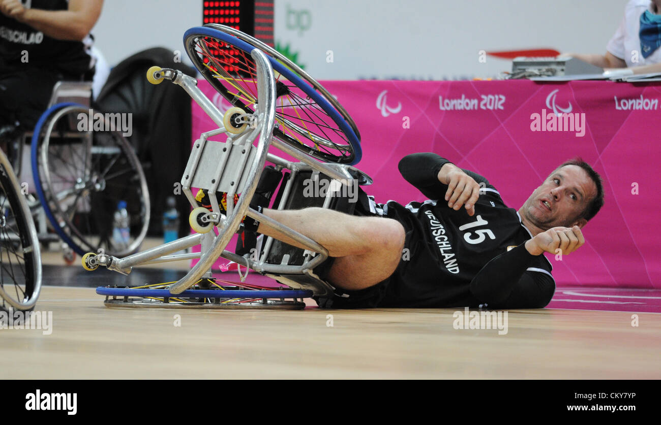 01.09.2012. London, England.  Dirk Koehler of Germany falls out his wheelchair during Men's - Group B Preliminary - Stock Image