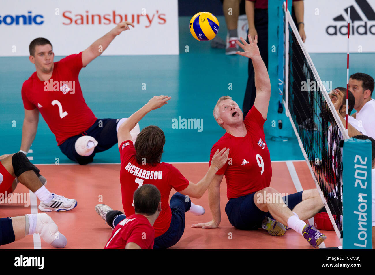 Great Britain's men's sitting volleyball team plays Morocco at the London Paralympic Games. Great Britain - Stock Image