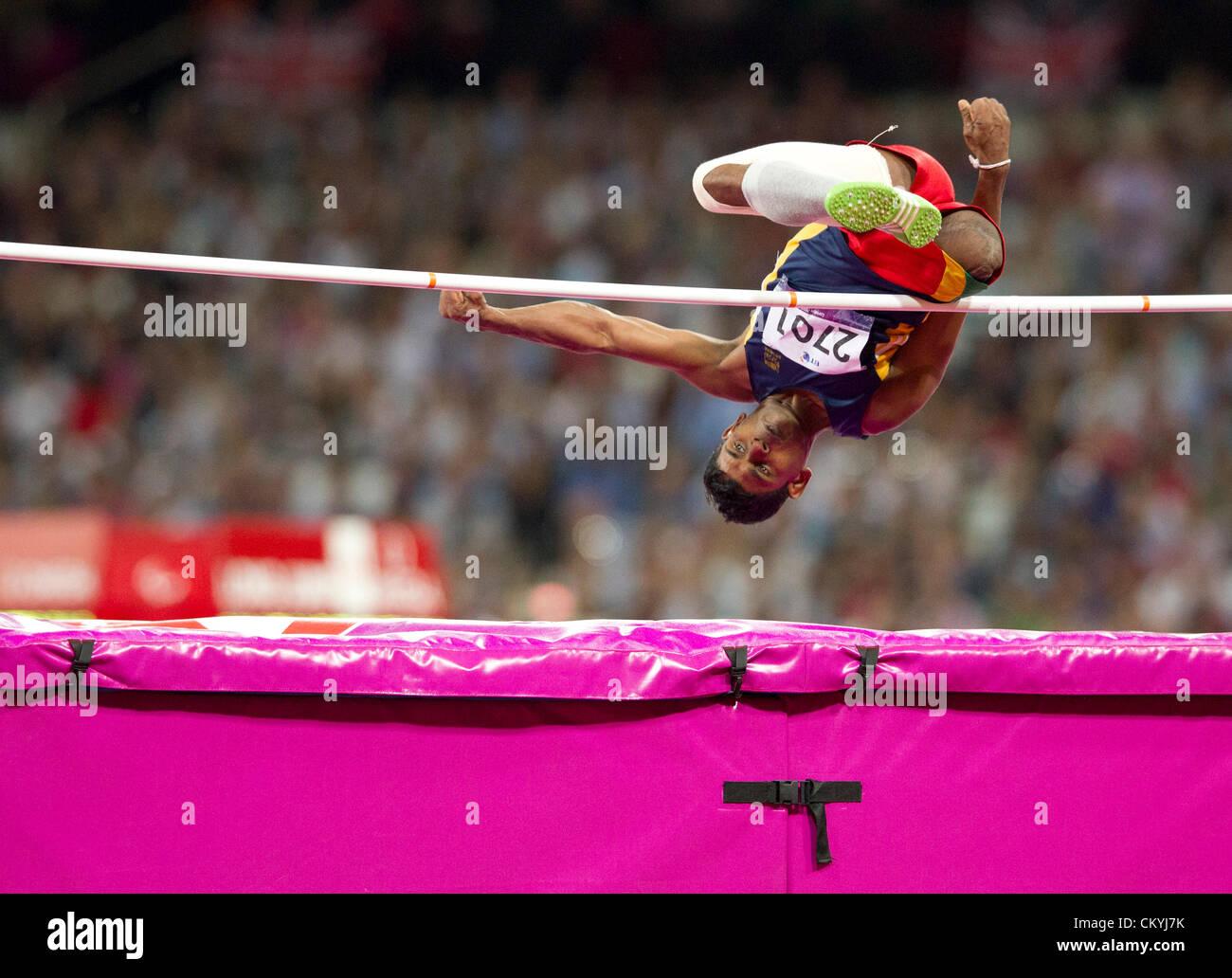 Sri Lanka's Lesly Kumara Dobagoda Liyanage flips over the high jump bar  in the men's F42 class at the London - Stock Image