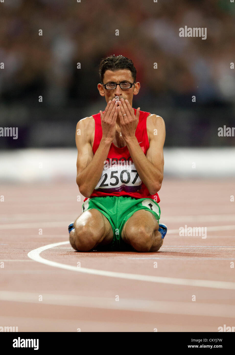 September 3, 2012 London, United Kingdom: El Amin Chentouf of Morocco (2507) sits on the Olympic track after winning - Stock Image