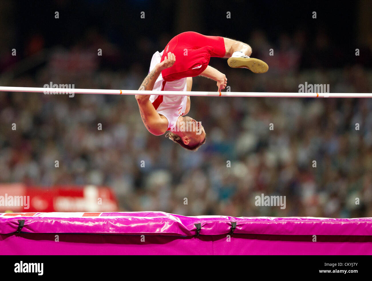 Poland's Lukasz Mamczarz heads over the high jump bar in the F42 class in Olympic Stadium at the London Paralympics - Stock Image