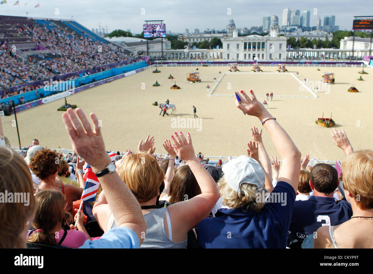 Fans at Greenwich Park equestrian venue cheer silently for horses, riders in Individual dressage 1A at the London Stock Photo