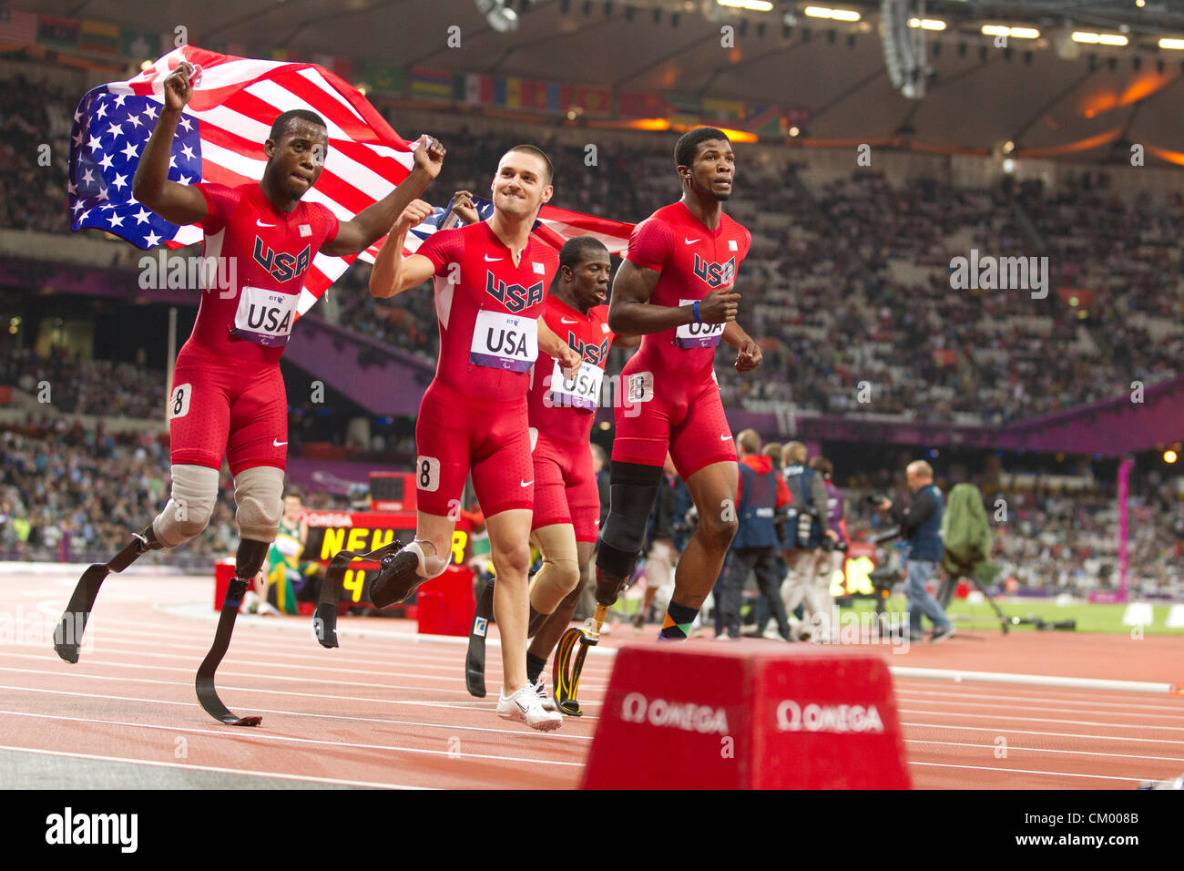 USA men's 4X100 meter T42-44  class relay team celebrates what the team thought was a medal finish at the Paralympics. - Stock Image